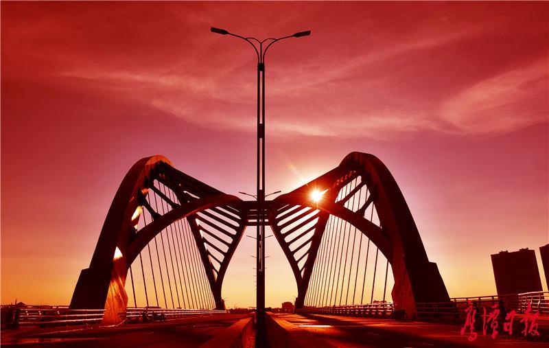 04鹰西大桥主桥桥型蝶飞燕式钢箱系杆拱桥,造形优美.jpg